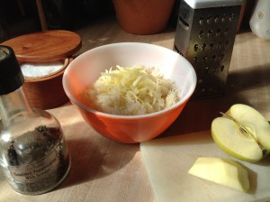 Grate an apple into the bowl of kraut
